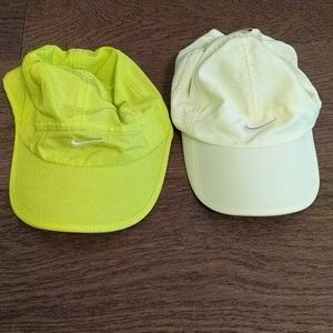 Two Nike running hats